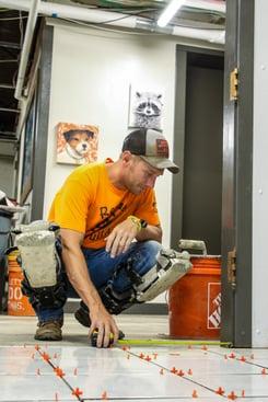 rescue rebuild team member installing new flooring