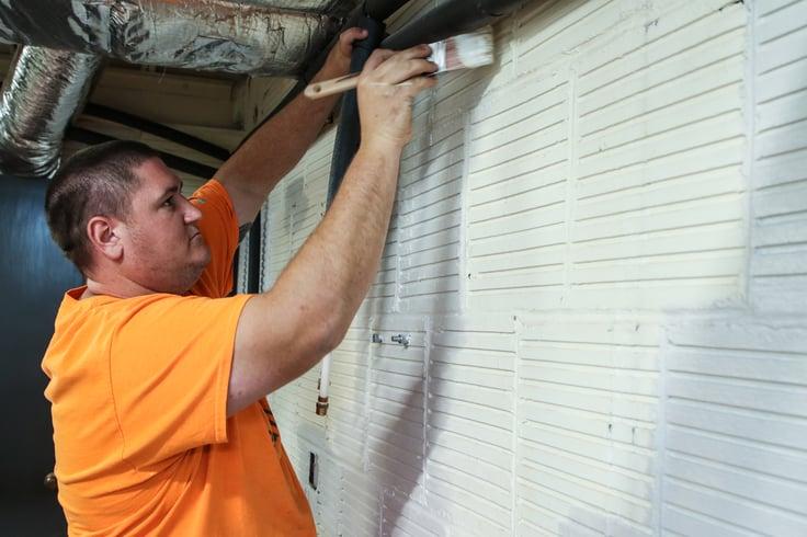 rescue rebuild team member painting