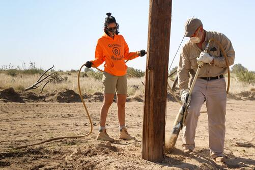 laying poles for fencing for neglected tigers