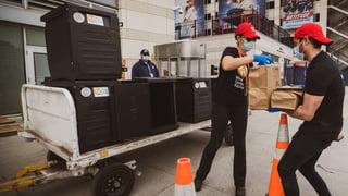 World Central Kitchen staff delivering meals