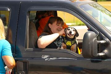 dog and owner at shelter drive thru