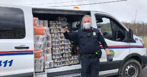 police officer distributing pet food