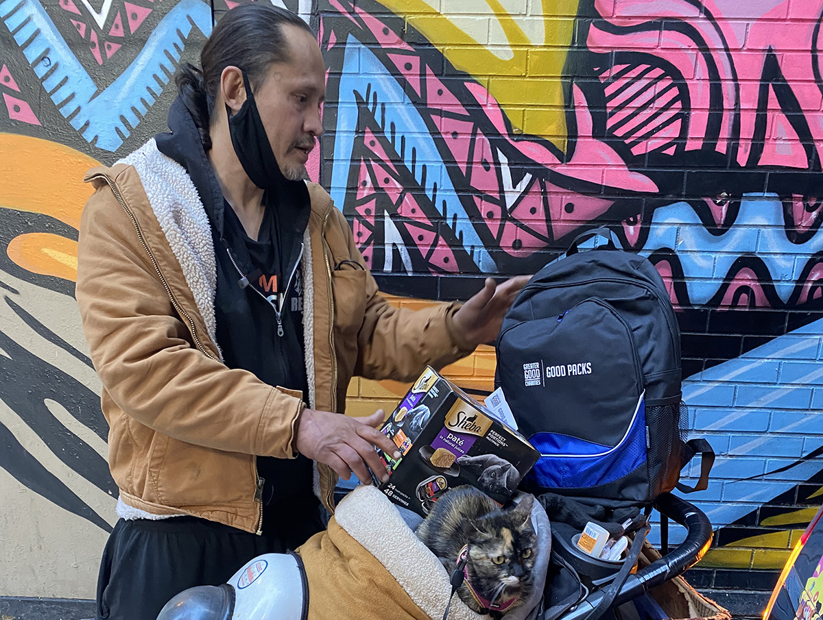 Man with Good Pack in Stroller with Cat and Supplies_©Paw Salvation-1