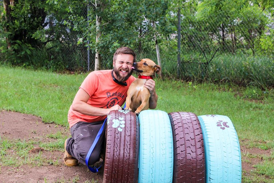 Rescue Rebuild - photo of Zac and a puppy at a renovation